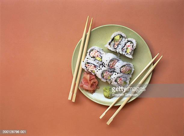 california sushi rolls on plate with chopsticks - sushi stock pictures, royalty-free photos & images