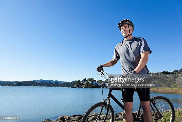 USA, California, Tiburon, Man riding bike along lakeshore