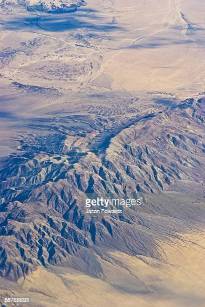 Rugged tectonic mountains rise from the desert plain near Los Angeles.