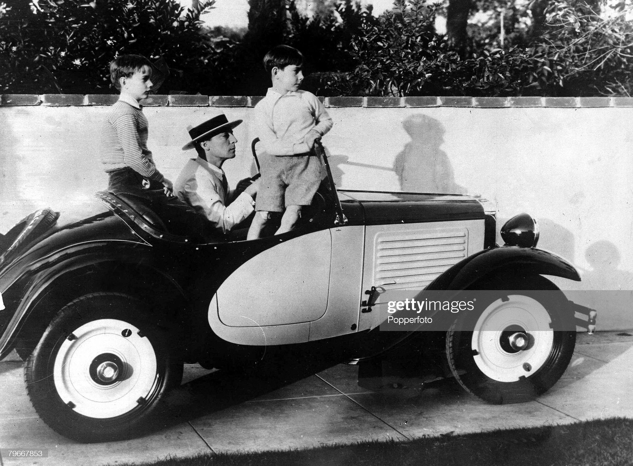 California, USA, 9th March, 1932, Silent film star Buster Keaton about to take his two sons Bob and Joe for a ride in his car in Hollywood : News Photo