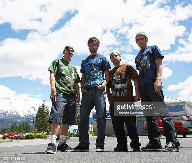 usa, california, weed, four young men in parking lot at truck stop - low angle view stock pictures, royalty-free photos & images