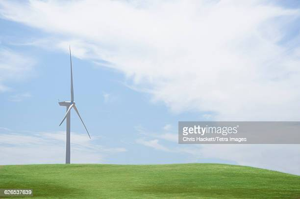usa, california, wind turbine in field on sunny day - hackett stock photos and pictures
