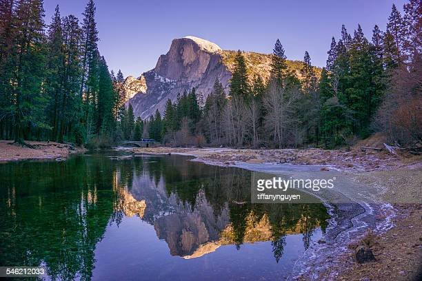 USA, California, Yosemite National Park, Half Dome reflecting in water