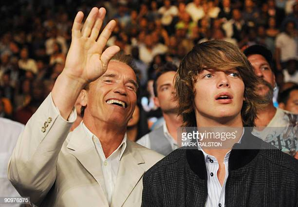 Californian Governor Arnold Schwarzenegger and his son Patrick watch boxers Juan Manuel Marquez of Mexico and Floyd Mayweather Jnr of the US during...