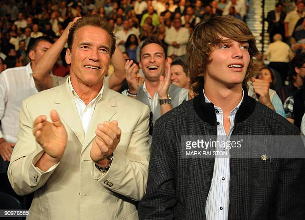 Californian Governor Arnold Schwarzenegger and his son Patrick watch boxers Juan Manuel Marquez of Mexico and Floyd Mayweather Jnr. Of the US during...