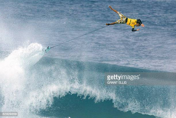 Californian Rob Machado wipes out in the Xbox Pipeline Masters surfing trials at the Banzai Pipeline North Shore on the Hawaiian island of Oahu 11...