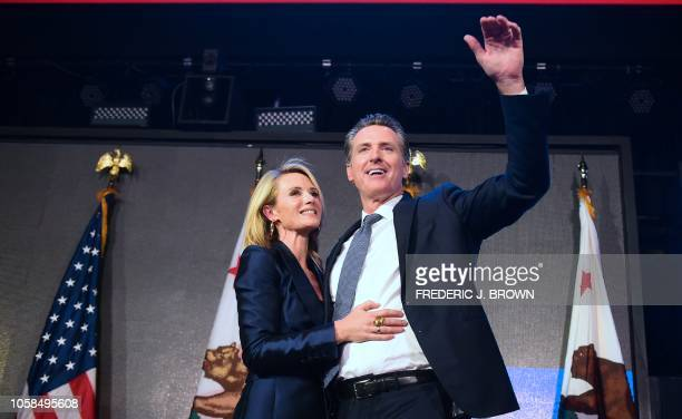 California's Democratic gubernatorial candidate Gavin Newsom gestures with his wife by his side at his election night watch party in Los Angeles...
