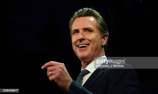 California's Democratic gubernatorial candidate Gavin Newsom speaks onstage at his election night watch party in Los Angeles, California on November...