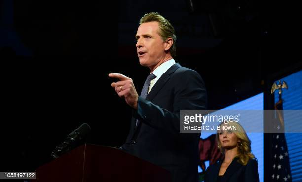 California's Democratic gubernatorial candidate Gavin Newsom watched by his wife Jennifer gestures while speaking at his election night watch party...