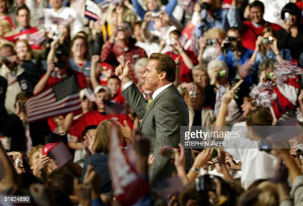 California's Governor Arnold Schwarzenegger greets supporters during a campaign rally for US President George W Bush at Nationwide Arena 29 October...