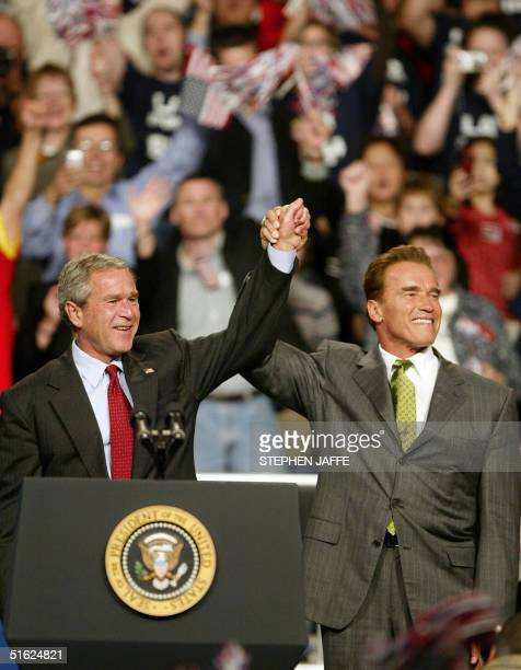 California's Governor Arnold Schwarzenegger introduces US President George W Bush during a campaign rally at Nationwide Arena 29 October in Columbus...