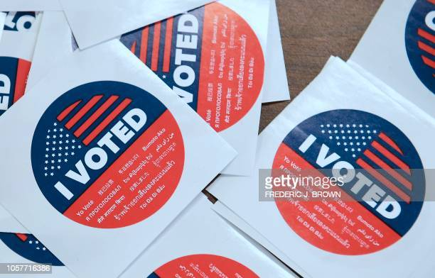 California's multilanguage I Voted stickers on offer for early voters at the Los Angeles County Registrar's Office in Norwalk California on November...