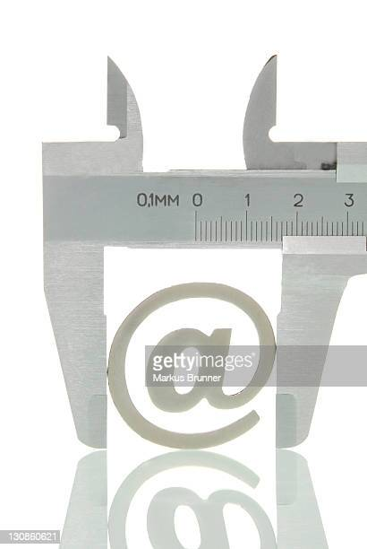 Calipers with the at-symbol, symbolic image for analysis of the Internet