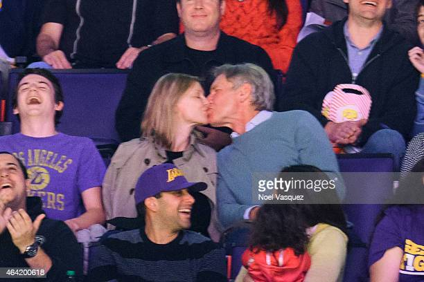 Calista Flockhart and Harrison Ford kiss at a basketball game between the Boston Celtics and the Los Angeles Lakers at Staples Center on February 22...
