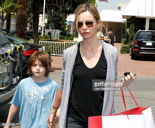 Calista Flockhart and Liam sighting at Fred Segal on August 22 2009 in Los Angeles California