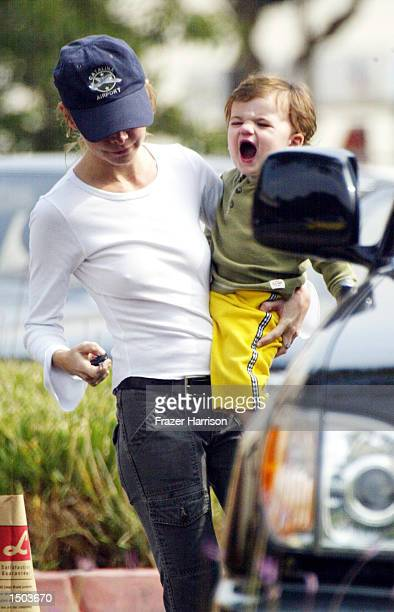 Calista Flockhart carries her son Liam to her car after shopping at Longs Drugs store October 18 2002 in Brentwood California