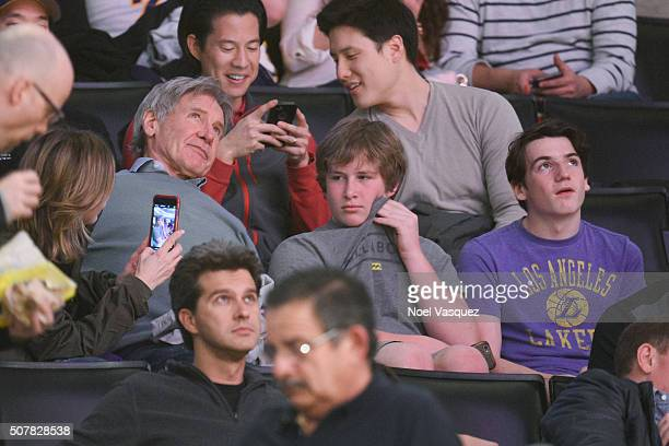 Calista Flockhart Harrison Ford and Liam Flockhart attend a basketball game between the Charlotte Hornets and the Los Angeles Lakers at Staples...