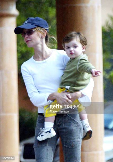 Calista Flockhart returns to her car with her son Liam 3after shopping at Longs Drugs store October 18 2002 in Brentwood California