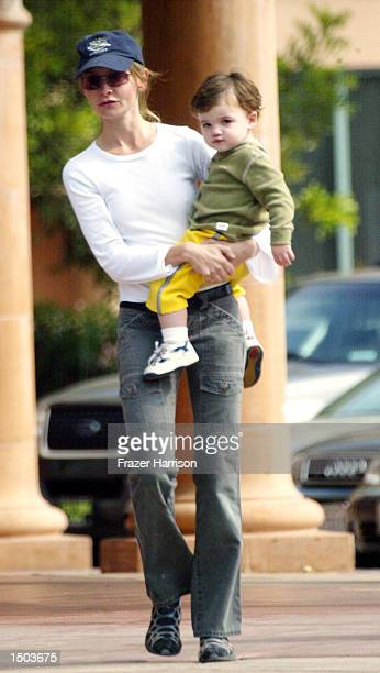 Calista Flockhart returns to her car with her son Liam after shopping at Longs Drugs store October 18 2002 in Brentwood California