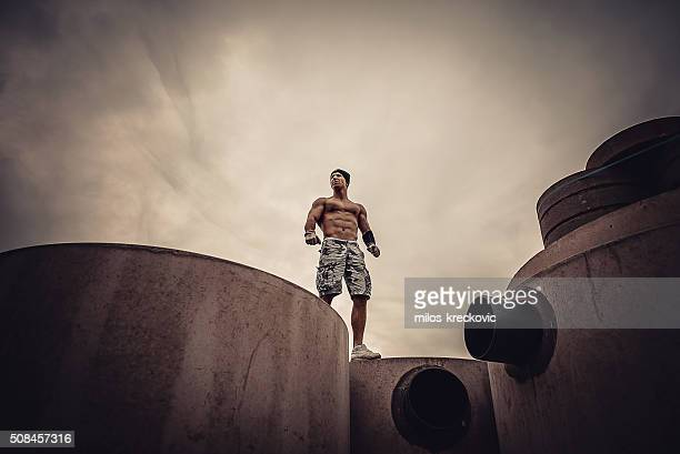 Calisthenics on concrete pillars.