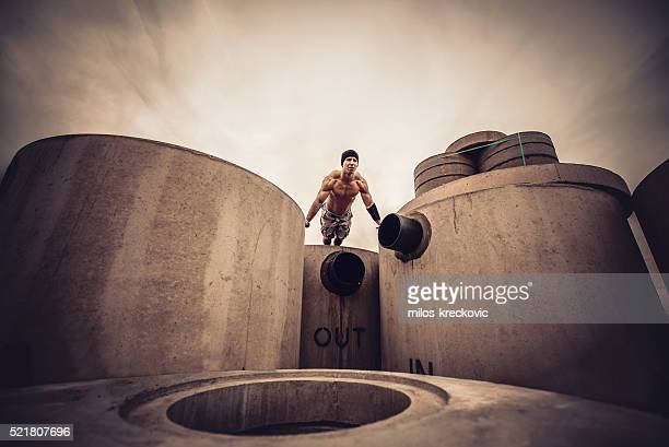 Calisthenics on concrete pillars.