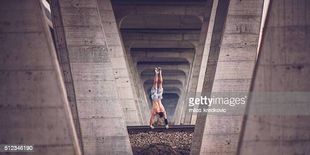 Calisthenics on railroad tracks.