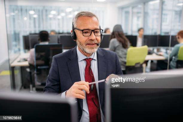 call center workers - stock trader stock pictures, royalty-free photos & images