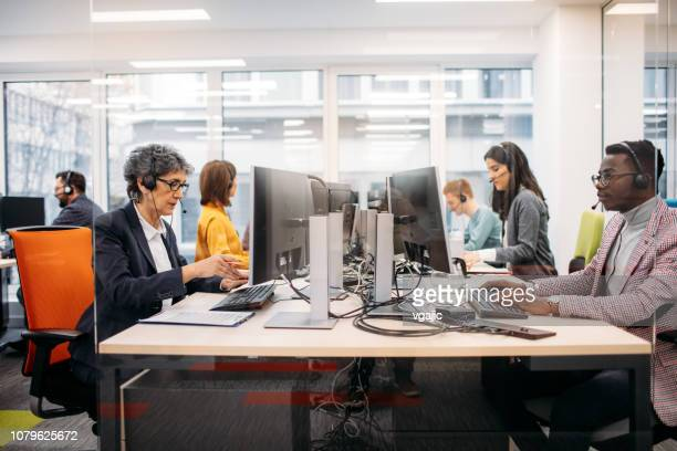 call center workers - call center stock pictures, royalty-free photos & images