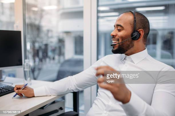 call center workers - contact us stock pictures, royalty-free photos & images