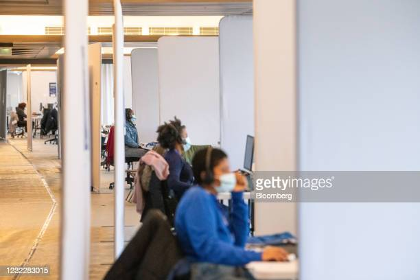 Call center workers process vaccine requests from inhabitants of the Saint Denis district at the Stade de France vaccination center in Paris, France,...
