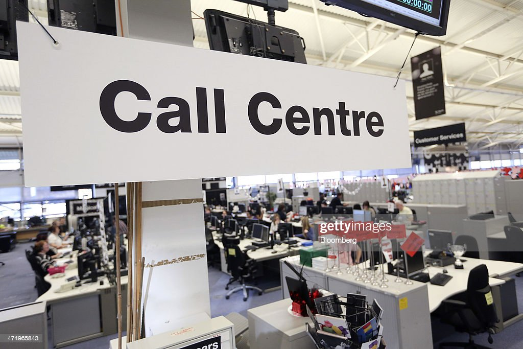 A 'Call Centre' sign hangs inside the customer service call center at First Direct bank, the online and telephone banking unit of HSBC Holdings Plc, in Leeds, U.K., on Wednesday, Feb. 26, 2014. HSBC Holdings Plc, Europe's largest bank, posted full-year profit that missed analyst estimates as a cost-cutting drive fell short of targets and revenue shrank. Photographer: Chris Ratcliffe/Bloomberg via Getty Images