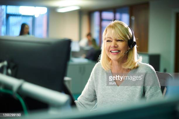 call centre worker - assistance stock pictures, royalty-free photos & images