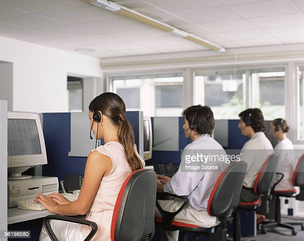 call centre workers, - call center stock pictures, royalty-free photos & images