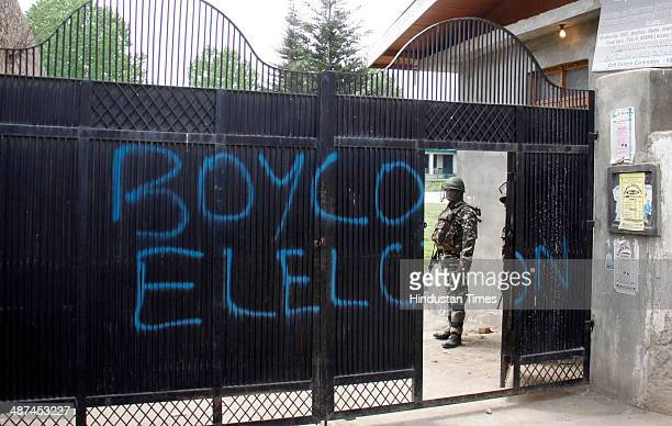 A call for boycott written on the gate of a school serving as poll station on April 30 2014 in Srinagar India Separatist groups call to enforce a...
