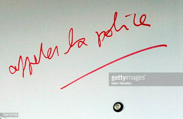 Call the police is written on the door at the entrance of the house of the Mokadem family at the General Jaques Avenue March 2 2007 in Nivelles...
