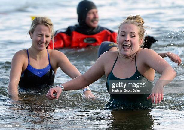 Calla Dilli right from Littleton and Sami Daniels from Aurora move as quickly as they can out of the water after their plunge Hundreds of...