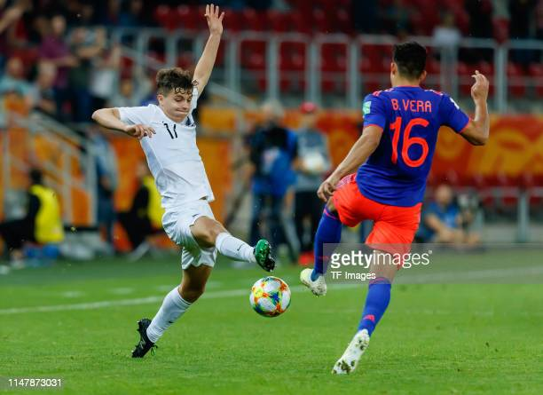 Callan Elliot of New Zealand and Brayan Vera of Colombia battle for the ball during the 2019 FIFA U20 World Cup Round of 16 match between Colombia...