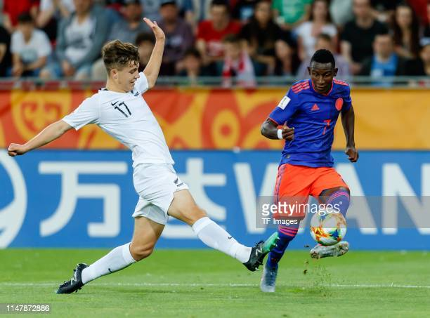 Callan Elliot of New Zealand and Ivan Angulo of Colombia battle for the ball during the 2019 FIFA U20 World Cup Round of 16 match between Colombia...