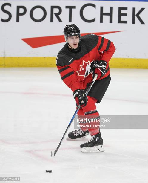 Callan Foote of Canada skates the puck against the Czech Republic during the first period of play in the IIHF World Junior Championships Semifinal...