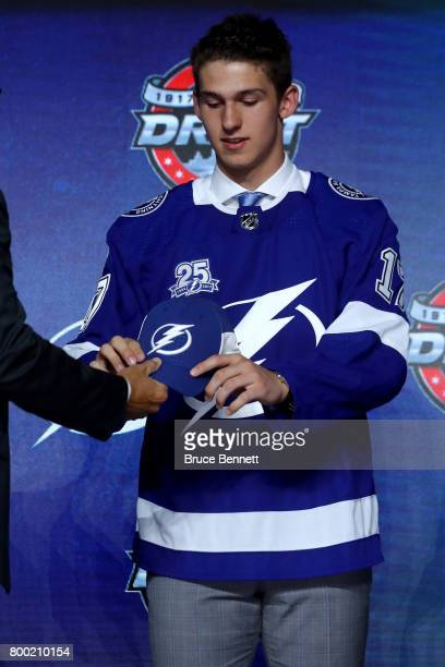 Callan Foote receives the Tampa Bay Lightning hat after being selected 14th overall during the 2017 NHL Draft at the United Center on June 23 2017 in...