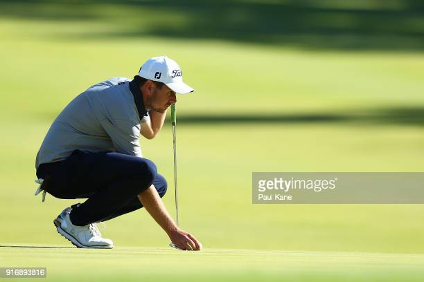 Callan O'Reilly of Australia places his ball on the third green in his match against Pavit Tangkamolprasert during day four of the World Super 6 at...