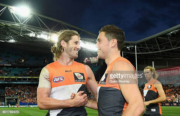 Callan Ward and Josh Kelly of the Giants celebrates kicking a goalebrate winning the AFL 1st Qualifying Final match between the Sydney Swans and the...