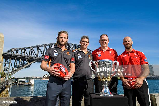 Callan Ward and Leon Cameron of the Giants along with John Longmire and Jarrad McVeigh of the Swans pose for a photo with the 2016 AFL Premiership...