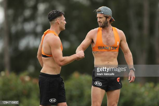 Callan Ward and Stephen Coniglio of the Giants bump fists after a 2km time trial during a Greater Western Sydney Giants AFL training session at...