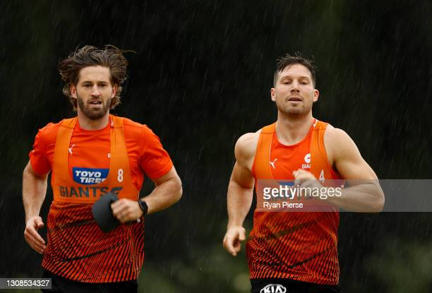 Callan Ward and Toby Greene of the Giants train during a GWS Giants AFL training session at Tom Wills Oval on March 23, 2021 in Sydney, Australia.