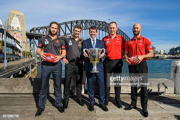 Callan Ward Leon Cameron Premier of NSW Mike Baird John Longmire and Jarrad McVeigh pose for a photo with the 2016 AFL Premiership Cup during an AFL...