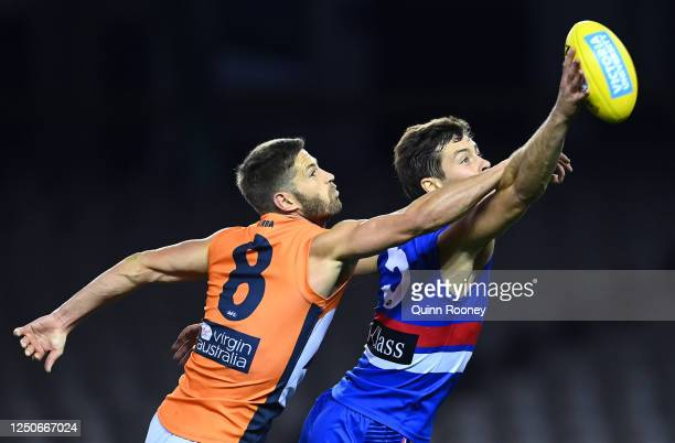 Callan Ward of the Giants and Josh Dunkley of the Bulldogs compete for the ball during the round 3 AFL match between the Western Bulldogs and the...