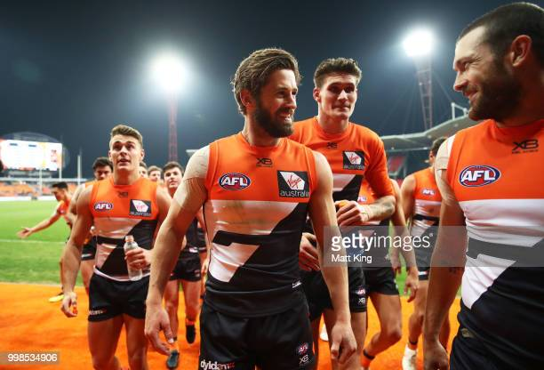 Callan Ward of the Giants and team mates celebrate victory after the round 17 AFL match between the Greater Western Sydney Giants and the Richmond...