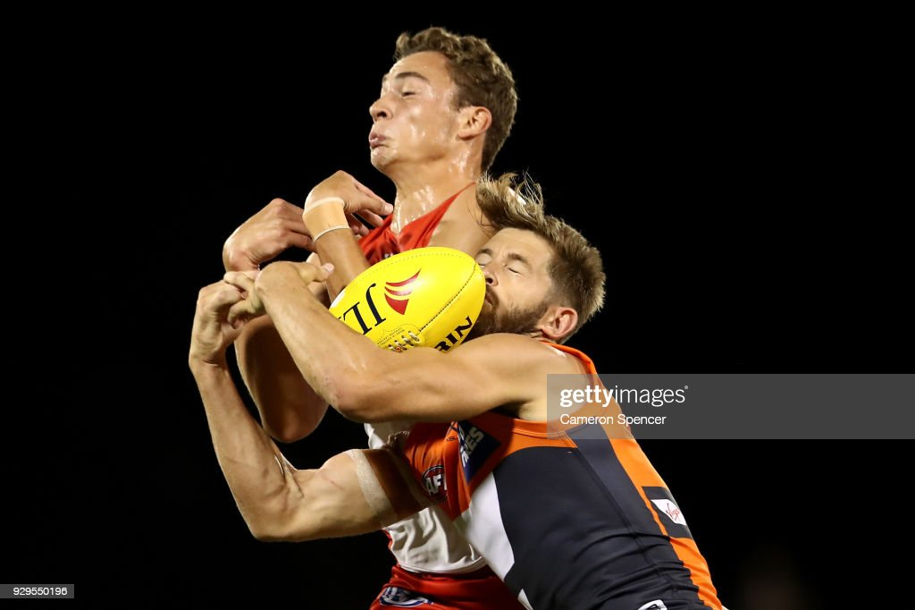 Callan Ward of the Giants and Will Hayward of the Swans contest the ball during the JLT Community Series AFL match between the Sydney Swans and the Greater Western Sydney Giants at Blacktown International Sportspark on March 9, 2018 in Sydney, Australia.