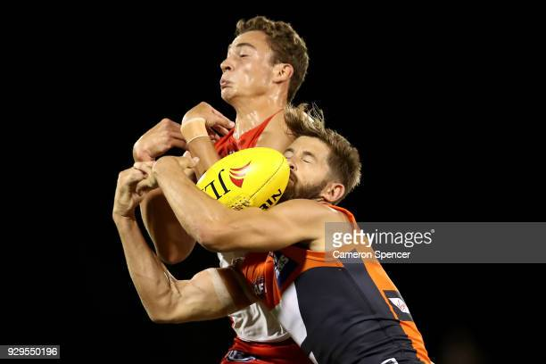 Callan Ward of the Giants and Will Hayward of the Swans contest the ball during the JLT Community Series AFL match between the Sydney Swans and the...
